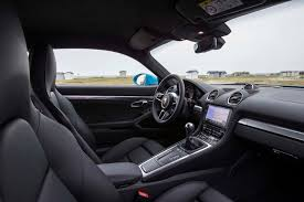 porsche electric interior 2017 porsche 718 cayman first drive review performance trumps