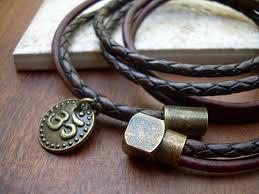leather bracelet clasps images Om charm triple wrap leather bracelet with an antique brass jpg