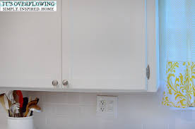 How To Update Kitchen Cabinets by Add Simple Trim And Paint To Cabinets Keep The Rounded Corners