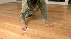 finishing proccess of hardwood flooring installation by cleaning