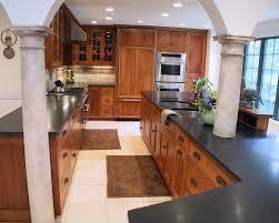 Mediterranean Kitchen Cabinets - hickory kitchen cabinets kitchen mediterranean with accent tile
