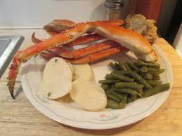 alaskan snow crab legs w sliced new potatoes green beans and