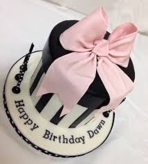 boxes with bows gift box cake with gum paste bow black white cake pink