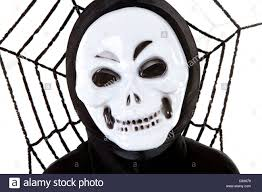 person with scary skull mask for halloween over white background