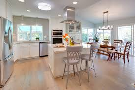kitchen style light hardwood floor white marble countertop