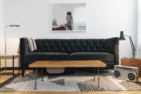 living room with black tuxedo sofa stylish streamlined tuxedo