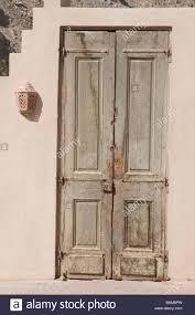 weathered wooden wood door doors faded fade sun backed texture
