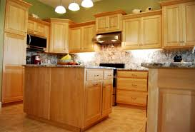nice kitchen design with wooden maple cabinets and marble