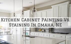 paint vs stain kitchen cabinets kitchen cabinet painting vs staining in omaha ne