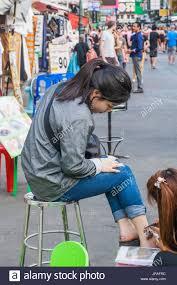 thailand bangkok khaosan road female asian tourist having henna