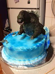 godzilla cake topper in the kitchen where food goes beyond the boundary of