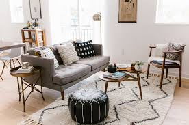 mixing mid century modern and rustic home tour mid century modern boho inspired condo green