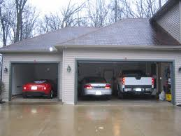 3 car garage door why keeping your car stored in the garage this winter is a good idea