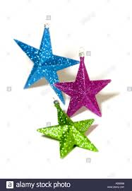 green blue and purple star christmas tree decorations on white