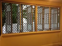 screened windows on queenslander house diamond grille