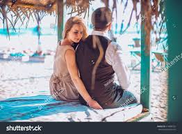 young couple beach bungalow cafe ocean stock photo 614809352