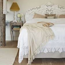 white ruffled bedding set and rustic side table for traditional