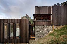coastal cliff house design idea with wooden structure home