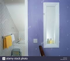 En Suite Bathrooms by Opaque Window In Mauve Wall Dividing En Suite Bathroom From Small