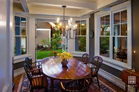 Traditional Dining Room With Chandelier By Locati Architects - Dining room with french doors