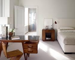 contemporary dark wooden small corner desk in in a white modern