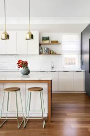 best 25 timber kitchen ideas on pinterest large kitchen sinks the rame brass plated pentant lights from mondo luce are real scene stealers in this kitchen by brett mickan