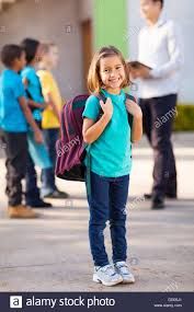 classmates search happy primary school student carrying backpack with classmates and