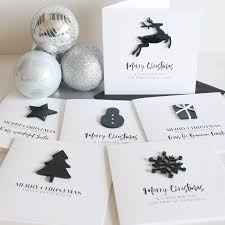 pack of four personalised monochrome christmas cards by the