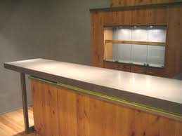 concrete top bar table concrete products used in a modern basement trueform decor