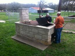 outdoor kitchen with smoker grill and bge outdoor patio