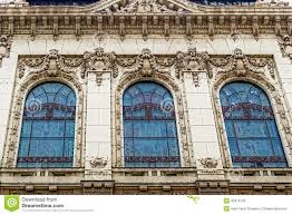 facade on classical building with ornaments and sculptures stock