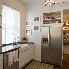space between top of refrigerator and cabinet ideas for using that awkward space above the fridge awkward
