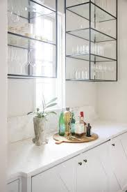 kitchen glass wall cabinets butlers pantry with wall mount iron and glass shelving unit