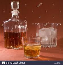 Drinks With Southern Comfort A Decanter Half Filled With Southern Comfort A Glass Of Southern