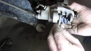 how to replace rear brake pads on a 2003 polaris sportsman 500 atv