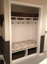 unused mudroom closet converted into a bench with hooks and
