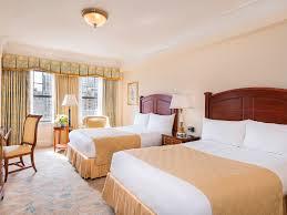 revel in the deluxe king interior view rooms at taj boston