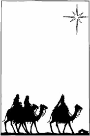 silhouette of the three wisemen riding their camels toward the