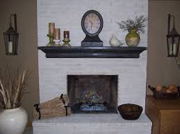 decor white brick fireplace with wooden planked mantle and wall
