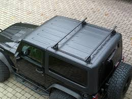small black jeep roof up on the roof awesome hatch roof last year we had a small