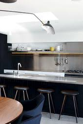 Stainless Steel Bench Top The Stainless Steel Bench Tops And Splashback In This Kitchen