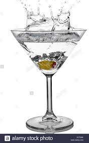 cocktail splash cocktail olive splash on martini glass with white background stock