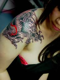 tattoo dragon shoulder shoulder dragon tattoo i like this idea but only with a phoenix