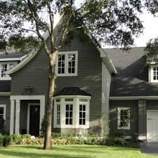 traditional home exterior design among grey wall siding combined
