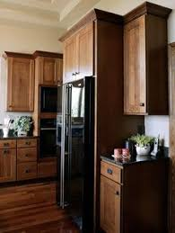 Oak Cabinet Kitchens Kitchen With Oak Cabinets With Black Appliances Bing Images