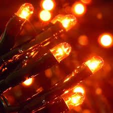 flicker flame string lights string lights 100 orange rice lights black wire plug in