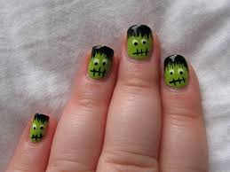 halloween monster nails purple and green ombre nails with witch on broom halloween nail art