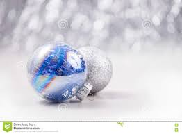 silver and blue christmas ornaments balls on glitter bokeh