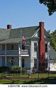 two story farmhouse stock images of american flag by two story farmhouse k3844796