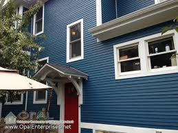 blue house white trim red white blue house blue hardie siding with white trim red door